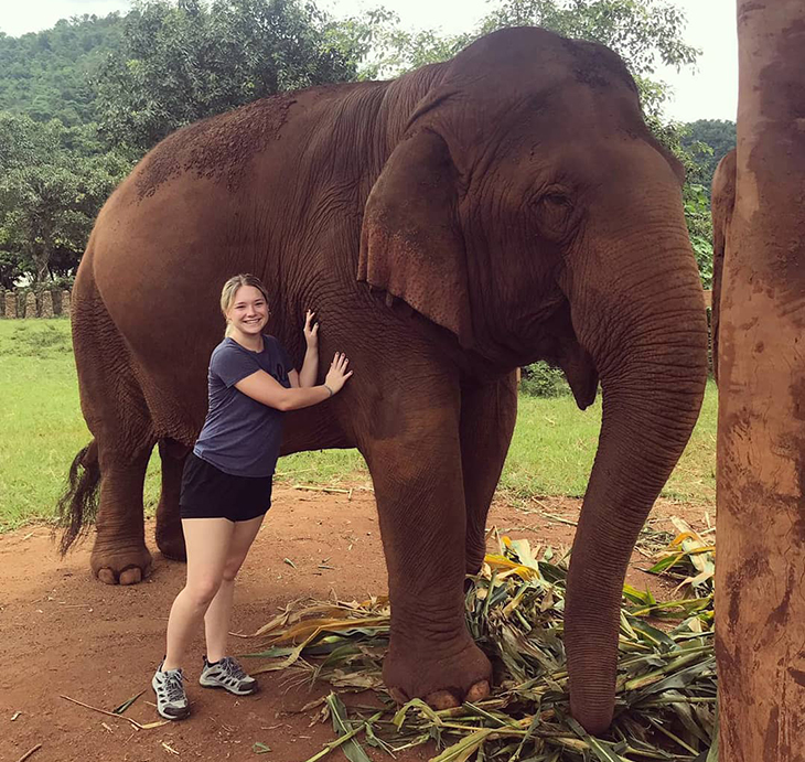 Amber Shelly with elephant in Thailand
